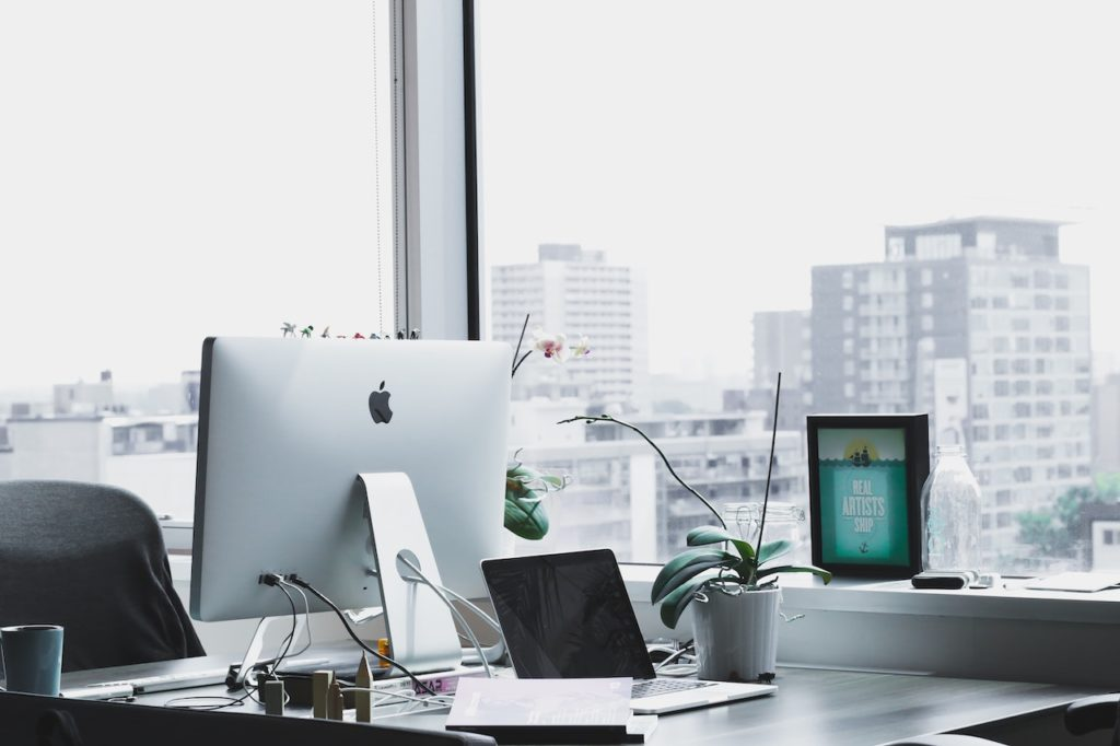 business hardware shown on desk by window showing city skyline