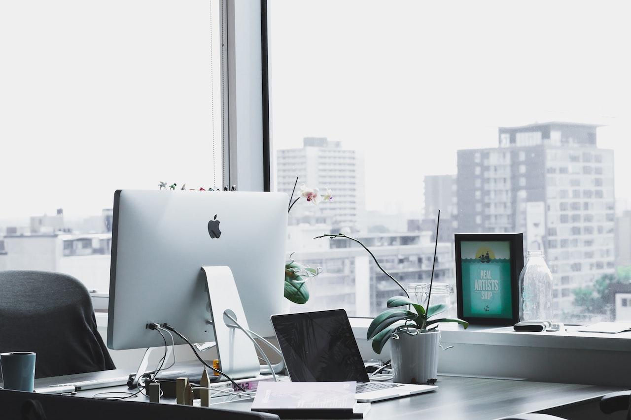 business hardware shown on desk by window showing city skyline